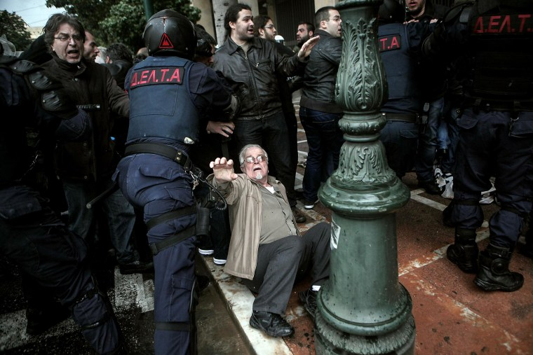 Greek Protesters Clash With Riot Police