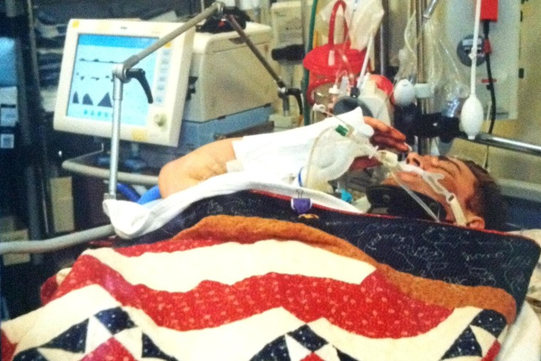 Sgt. Josh Hargis salutes from his field hospital bed in Afghanistan.