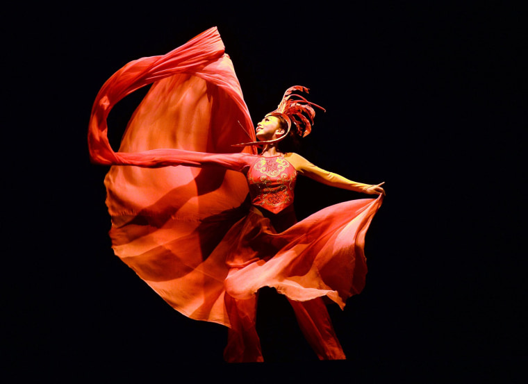 A dancer with the China Ningbo Performance & Arts Group performs a scene from 'The Red Dress' during a dress rehearsal before opening night on March 6 at the David H. Koch Theater at the Lincoln Center in New York City.  The production, which runs March 6-9,  marks the first time the dance theater piece has been performed in a major city outside of Asia.