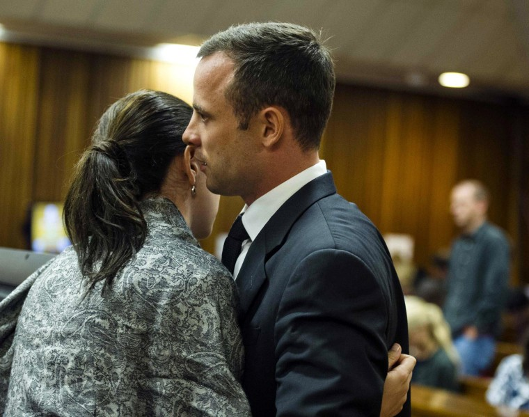 Image: Oscar Pistorius hugs his sister Aimee on the fifth day of his trial