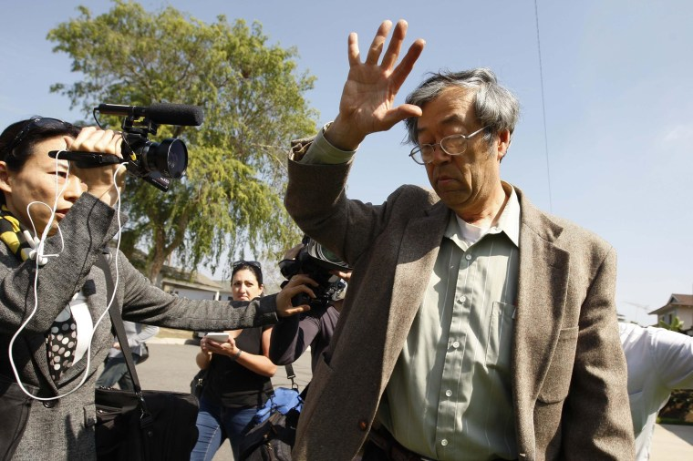 Image: A man widely believed to be Bitcoin currency founder Satoshi Nakamoto is surrounded by reporters as he leaves his home in Temple City, California