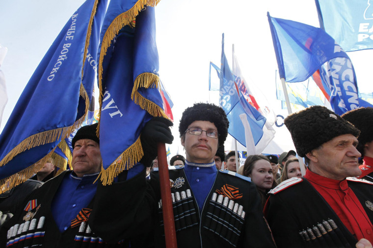 People hold a rally in the Russian southern city of Stavropol, in support of the people of Crimea on Friday.
