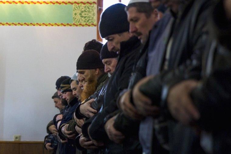 Image: Crimean Tatars pray in the Khan Chair mosque in Bakhchisaray, near Simferopol