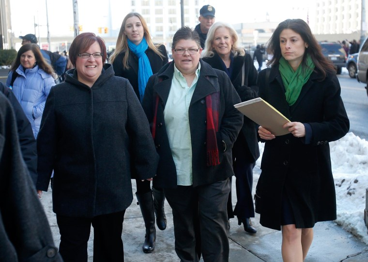 Image: April DeBoer and Jayne Rowse leave court with their attorney