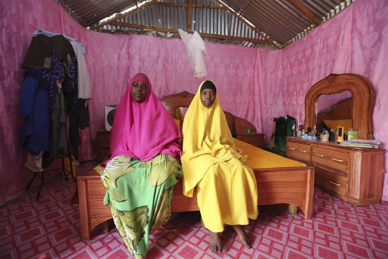 Image: Saciido Sheik Yacquub poses for a picture with her daughter Faadumo Subeer Mohamed at their home in Hodan district IDP camp in Mogadishu