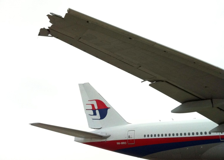 Image: The broken wing of a Malaysian Airline Boeing 777-200 passenger jet a day after it collided with a China Eastern Airline A340 plane