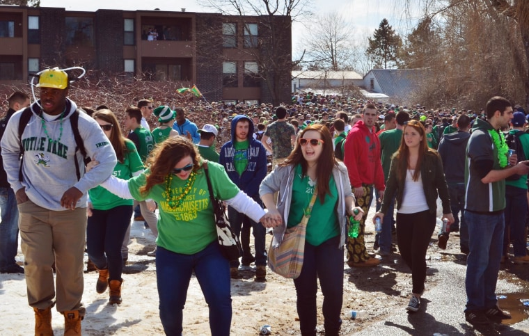 "Image: People gather for the pre-St. Patrick's Day ""Blarney Blowout"" near the University of Massachusetts in Amherst"