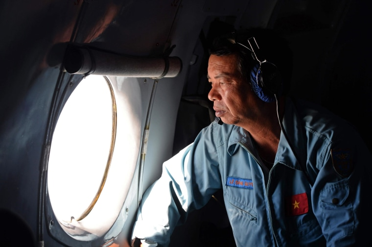 Image: A Vietnamese Air Force officer looks out a window over the southern seas off Vietnam on March 9, 2014.