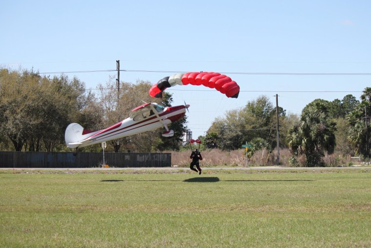 A plane became entangled in the strings of a skydiver's parachute, sending both crashing into the ground near Tampa, Fla. on March. 8, 2014.