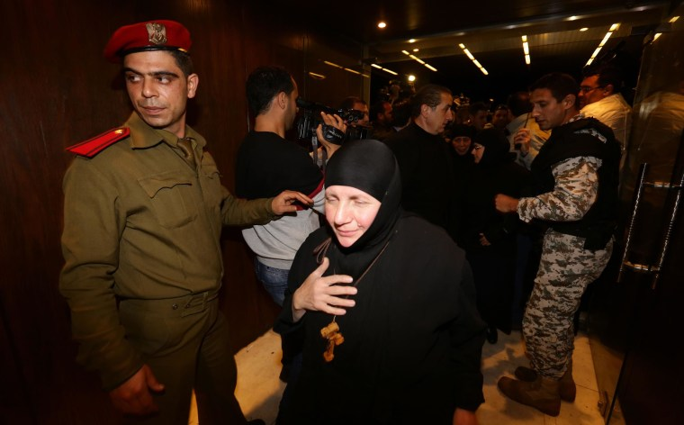 Image: Kidnapped nuns arrive at Jdeidet Yabus on the Syrian side of the border with Lebanon