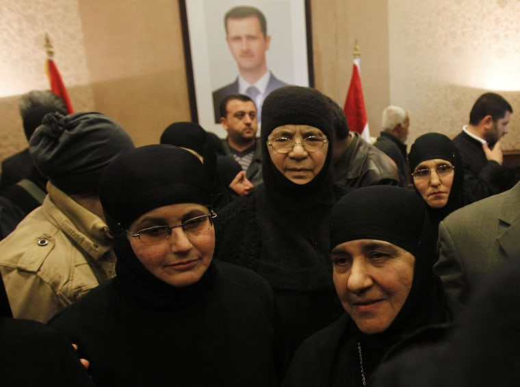Image: Nuns, who were freed after being held by rebels for over three months, arrive at the Syrian border with Lebanon