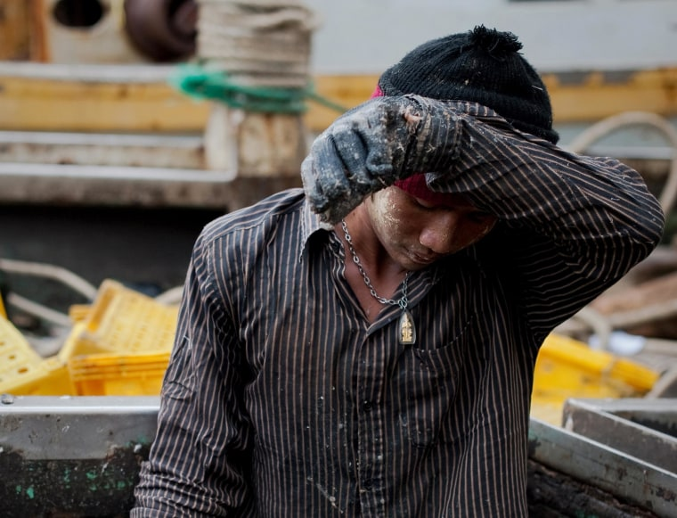 Migrant laborer on a Thai fishing boat on September 1, 2011 in Sattahip, Thailand's Rayong province. Thousands of men from Myanmar and Cambodia set sail on Thai fishing boats every day, but many are unwilling seafarers -- slaves forced to work in brutal conditions under threat of death.