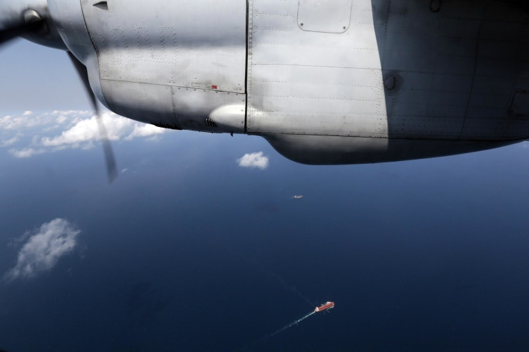 Ships are seen from a Vietnam Air Force AN-26 during a search operation for the missing Malaysian Airlines Boeing 777 over the South China Sea.
