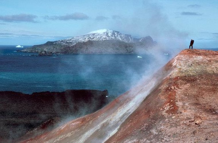 A man stands in a cloud of volcanic steam in the Antarctic South Sandwich Islands.