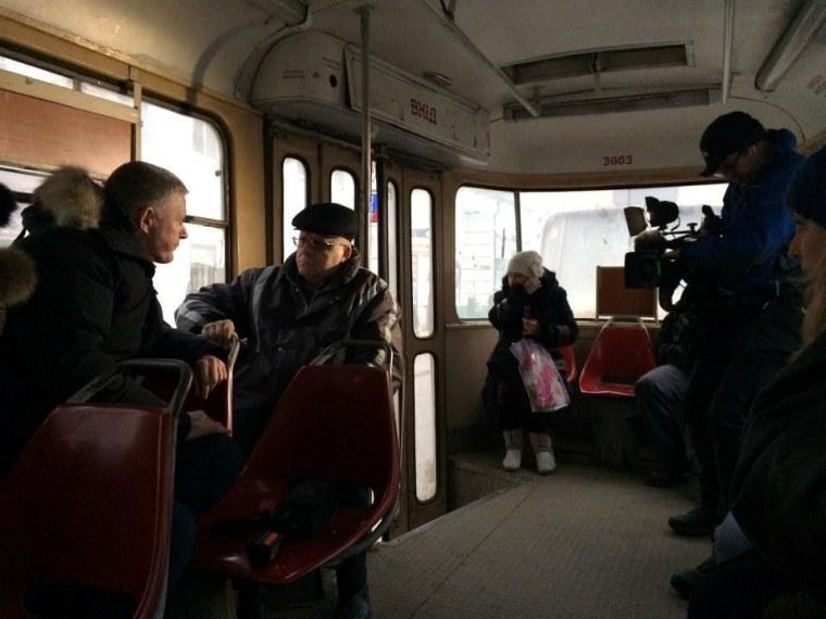 Ian Williams talks to Ukrainians on the tram in Kharkiv, Ukraine.