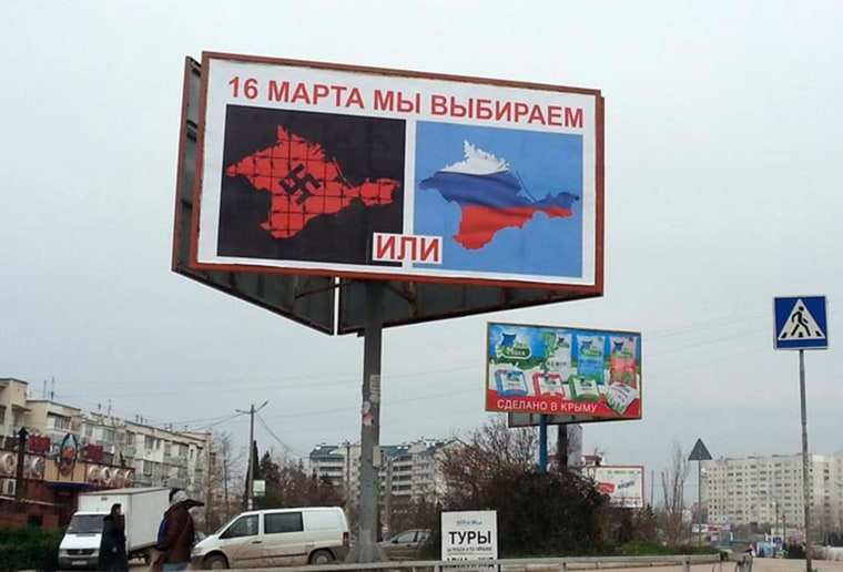 Image: A sign in Crimea depicts the rest of Ukraine as Nazis.