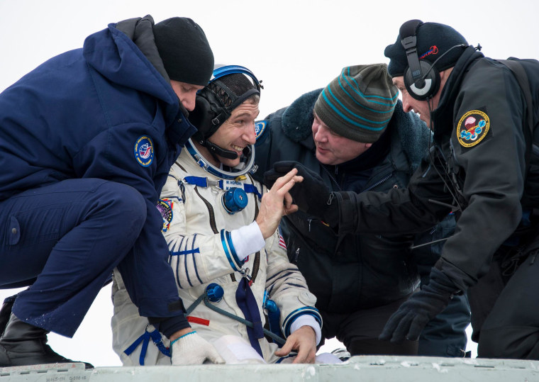 Image: Astronaut Hopkins from NASA is helped out of the Soyuz TMA-10M capsule shortly after the landing in a remote area southeast of Zhezkazgan