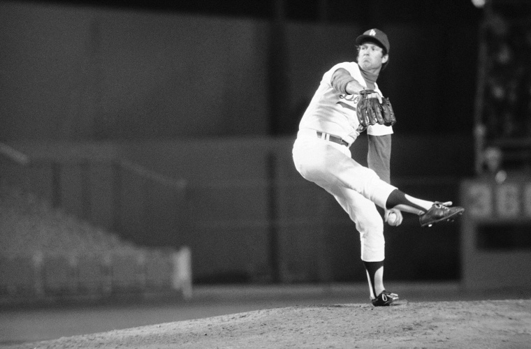 The Dodgers' Tommy John, whose throwing arm was repaired in a radical operation in 1974, pitches his first victory since July 1974, as he downed Pittsburgh on April 29, 1976 in Los Angeles.