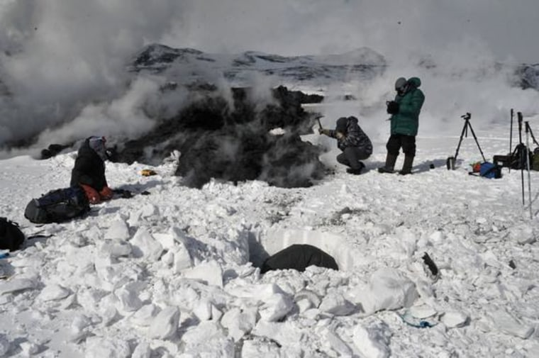 Image: Digging a snow pit near a lava flow at Russia's Tolbachik volcano in April 2013