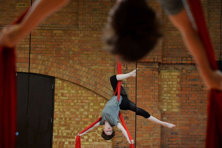 Image: Student Lydia Harper performs on the silks during a photocall for the launch of Britain's National Center for Circus Arts