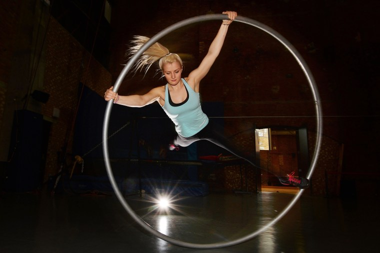 Image: Student Jessica Ladley performs on the cyr wheel during a photocall for the launch of Britain's National Center for Circus Arts