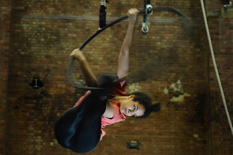 Image: Student Joana Dias performs on the aerial hoop during a photocall for the launch of Britain's National Center for Circus Arts