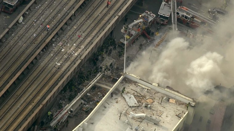 View from NBC New York helicopter of a building has collapsed in Manhattan after a report of an explosion, authorities say. FDNY said it was responding to 116th Street and Park Avenue. Smoke could be seen from midtown, a few miles away.