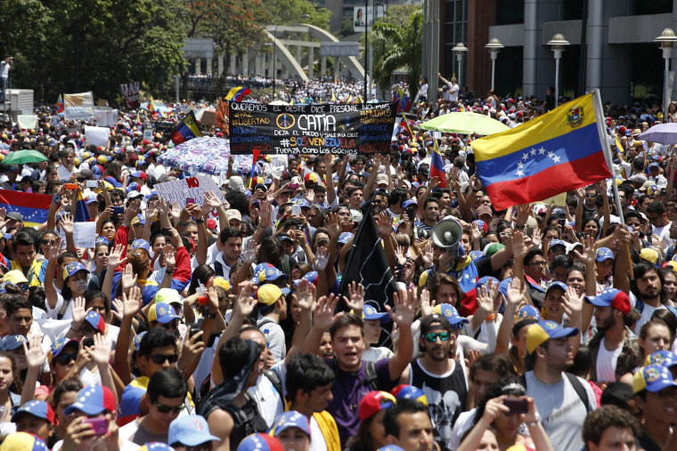 Image: Anti-government protesters march during a demonstration in Caracas