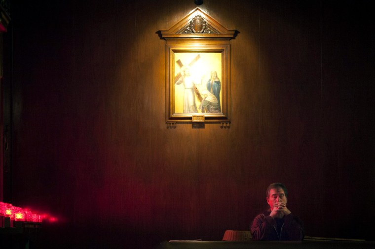 Image: A man prays during a service at St. Andrew's church in observance of Ash Wednesday in the Manhattan borough of New York