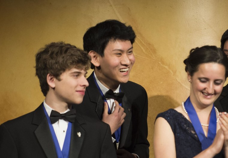 San Diego high schooler Eric Chen, 17, (center) won first-place and $100,000 in the Intel Science Talent Search.