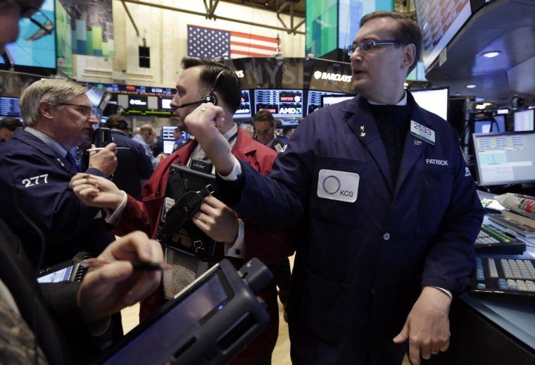 Traders at the New York Stock Exchange on Thursday when the Dow dropped 231 points on concerns over China and Ukraine.