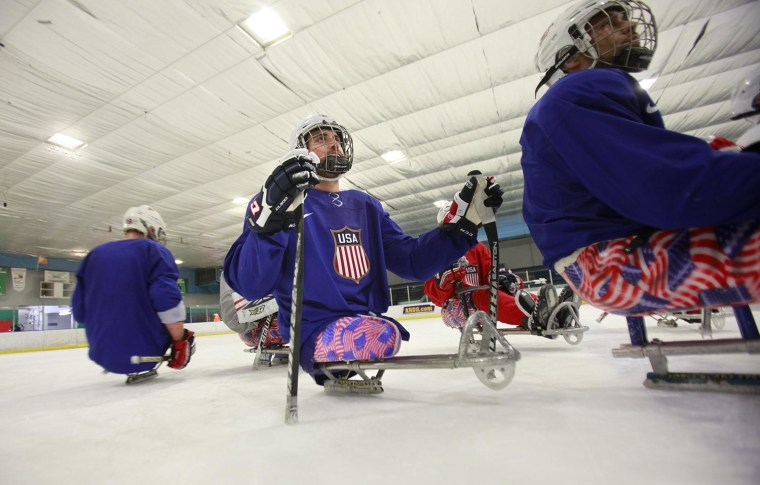 Image: The 2014 U.S. Paralympic sled hockey team practices in Colorado