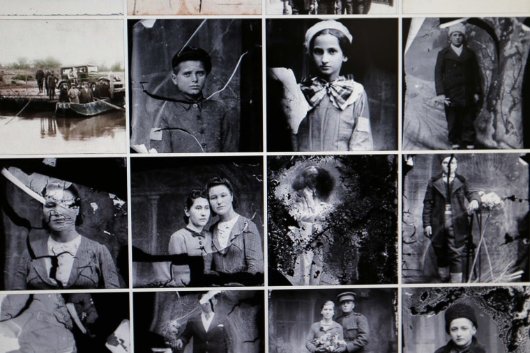 """Image: Images scanned from """"Costica Acsinte"""" picture archive are pictured on a monitor in Slobozia"""