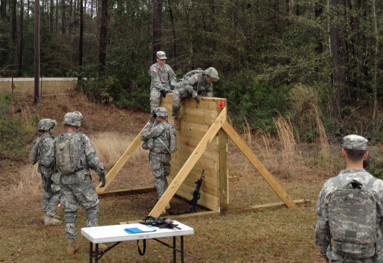 Soldiers climb a six-foot wall during Physical Demands Study at Fort Stewart, Ga.