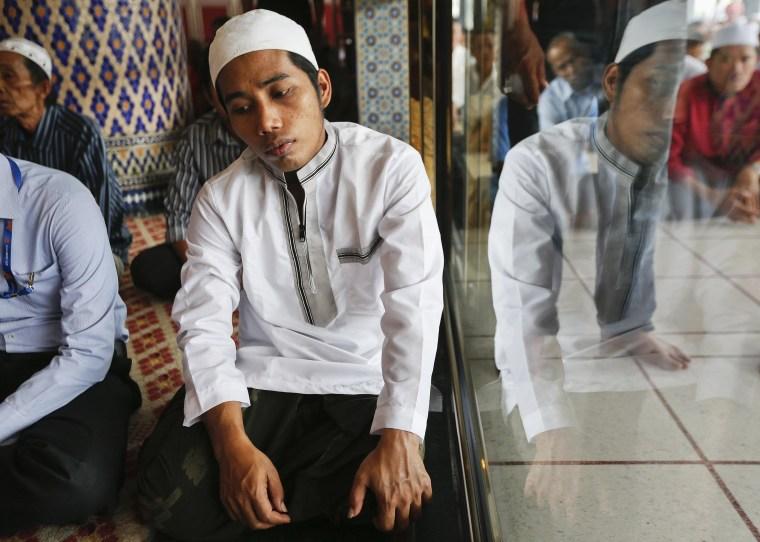 Image: Muslims pray during Friday prayers at National Mosque in Kuala Lumpur