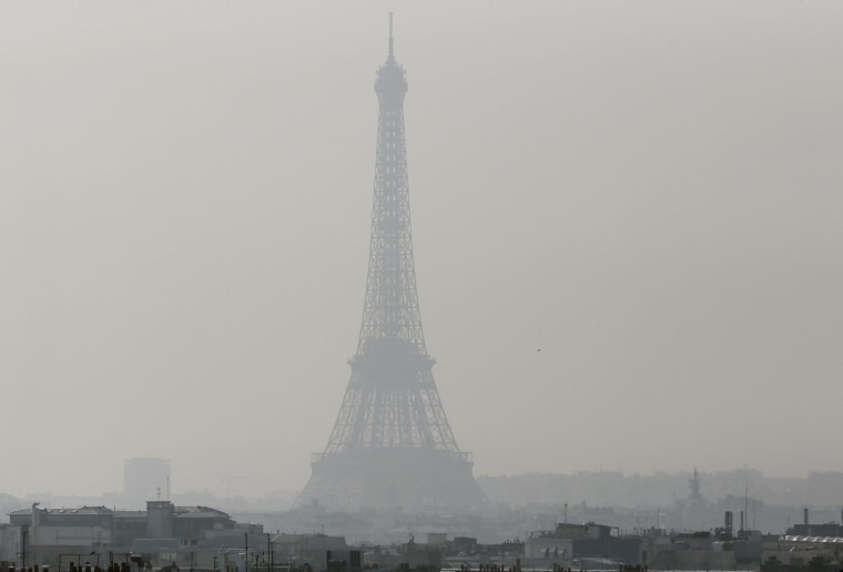 Image: A view of the Eiffel Tower seen through thick smog,