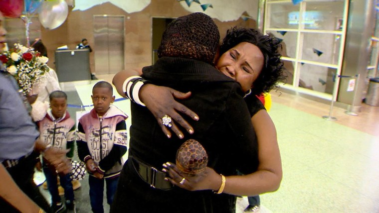 Image: Amira Ali embraces her daughter Tina at Denver airport after having been separated from each other for 24 years