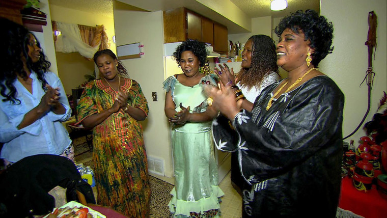 Image: Friends and family celebrate their reunion with traditional song and food