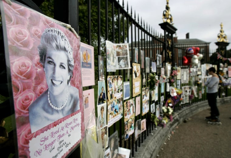 Pictures, notes and flowers placed by people are seen on the grounds of Kensington Palace in London, on the 10-year anniversary of the death of Princess Diana, Friday Aug. 31, 2007. It has been 10 years since her death in a Paris car crash, when many Britons were poleaxed by grief for a vivacious and troubled woman who was at once princess, style icon, charity worker and tabloid celebrity. (AP Photo/Lefteris Pitarakis)