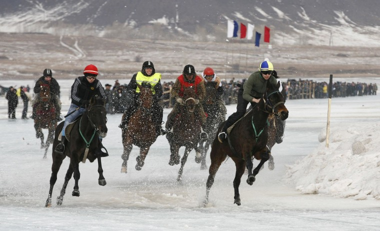 Image: Riders compete on the frozen Yenisei River during the 44th Ice Derby amateur horse race near the settlement of Novosyolovo