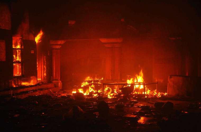 Image: A Hindu temple burns after it was attacked in Larkana