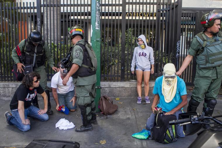 Image: Members of the Venezuelan National Guard detain demonstrators