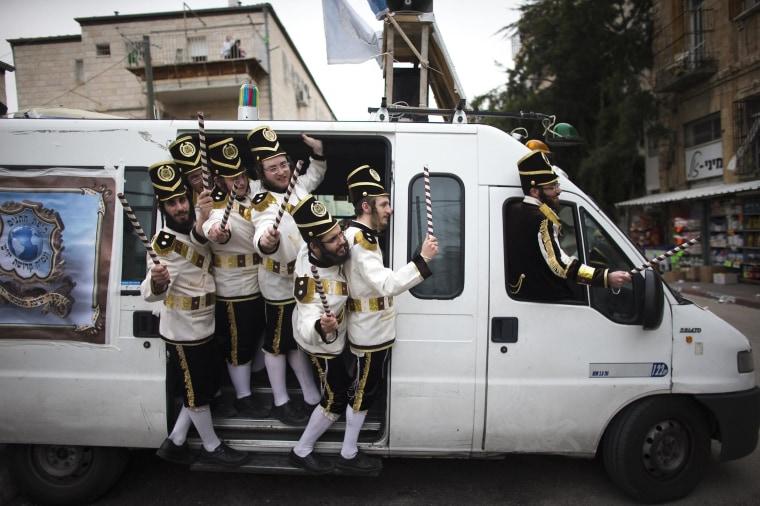 Image: Ultra-Orthodox Jewish men wearing costumes celebrate Purim in Jerusalem's Mea Shearim neighbourhood