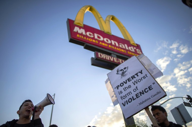 Image: Protesters march outside McDonald's in Los Angeles