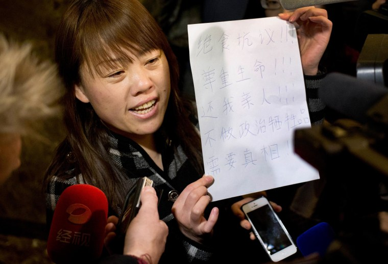 Image: A relative of a Chinese passenger aboard the missing Malaysia Airlines Flight 370