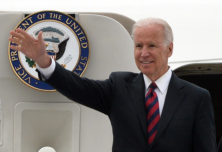 Image: Vice President Joe Biden waves as he leaves his plane after arriving in Warsaw, Poland