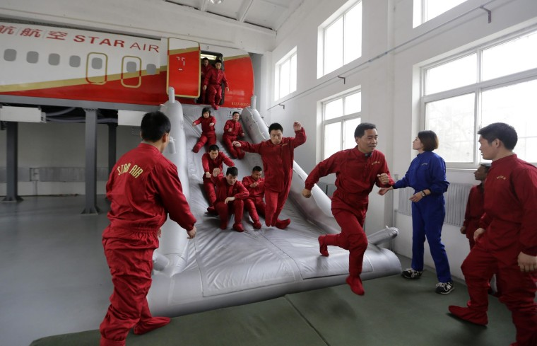 Image: Trainees practice emergency evacuation on the outskirts of Beijing