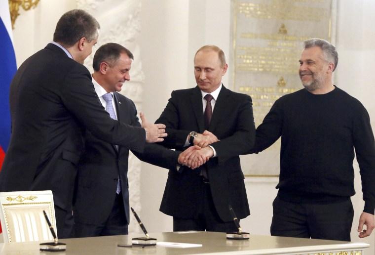 Image: Russia's President Putin, Crimea's PM Aksyonov, Crimean parliamentary speaker Konstantinov and Sevastopol Mayor