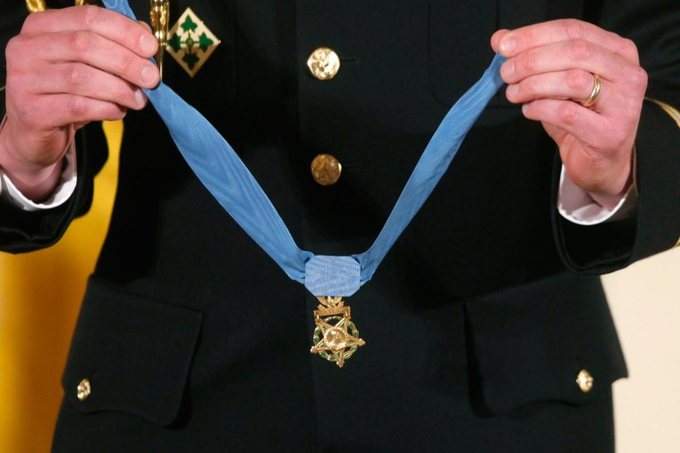 A military honor guard holds the Medal of Honor during a ceremony at the White House.