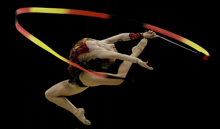 Image: Argentine Evelyn Mast competes in the X South American Games (Odesur) rhythmic gymnastics competition in Santiago, Chile